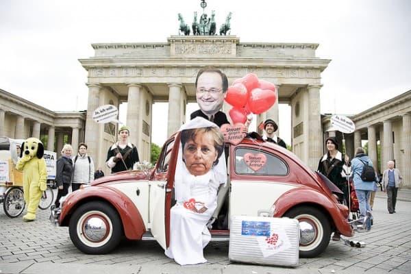 מחאה בברלין בעת ביקורו של נשיא צרפת הולנד בגרמניה. צילום: Robin Hood tax
