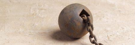 כדור ברזל, שלשלת, אסיר, עבדות